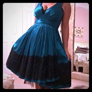 Emerald silk and black lace fifties style dress